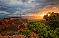 Warm Glow on the Monument (RondaKimbrow) Tags: morning sun storm nature clouds sunrise landscape colorado hiking scenic sunburst geology nationalparks grandjunction coloradonationalmonument rondakimbrowphotography