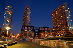 Long Island City, Queens (SunnyDazzled) Tags: park city nyc longexposure railroad newyork history night train buildings island lights pier high long cityscape state bridges engineering queens transfer rise 1925 gantry railcarfloats