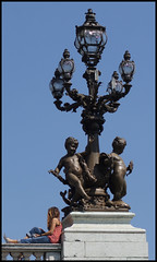 pont alexandre III .... lampost detail (ana_lee_smith) Tags: travel bridge blue sky paris france detail tourism seine architecture river lens photography gas clear artnouveau beercan lampost 1900 copper lamps ornate opulent cherubs pontalexandreiii elaborate beauxartes photosofparis analeesmith minoltaaf70210mm sonyalphaslta33
