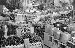 Hong Kong Dried Foods Market (Pexpix) Tags: blackandwhite bw hk film monochrome shop hongkong market merchandise shopkeeper kodak400tmax 4002tmy leica28mmsummicronmf2asph id111323c leicampsilver leica28mmsummicronmf2asphleica28mmsummicronmf2asphleica28mmsummicronmf2asph