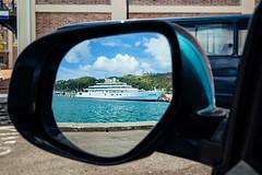 Objects in Mirror (ModernDayGilligan) Tags: mirror yacht grenada sidemirror motoryacht risingsun carmirror stgeorgesgrenada thecarenage