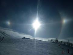 Halo on the slopes (Bradley J-S) Tags: sun snow mountains weather clouds rainbow halo meteorology parhelia phenomena lesarc lesarc2000 jemmettsmith