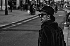 IMG_9436-Edit (roger_thelwell) Tags: life street city uk winter portrait england people urban bw white black streets cold london lamp monochrome westminster beauty hat rain leather mobile umbrella hair bag walking real photography mono chat shiny phone traffic post natural photos britain circus cigarette candid cab taxi great over sac hats cell photographic smoking lamppost photographs oxford conversation shiney talking shoulder handbag stud speak speaking studs commuters scak