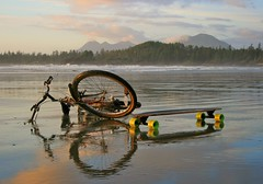 Wheels on the beach (ebbtidearts) Tags: reflection beach water bike bicycle wheels tofino skateboard