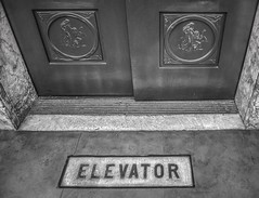 Manchester Unity Building (phunnyfotos) Tags: phunnyfotos australia victoria vic melbourne architecture building 1932 manchesterunity interior inside detail details marcusbarlow deco artdeco style design lobby liftlobby nikon d750 nikond750 mono bw monotone elevator lift door sign font text lettering logo