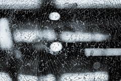 Crack! (marekbarto) Tags: white black broken glass monochrome airport dubai bokeh cracked