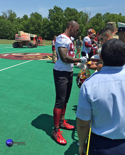 Former Terp, TE Vernon Davis signs autographs as a Redskin on opening day of OTAs.