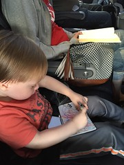 "Paul Colors with Mommy on the Airplane to Dallas • <a style=""font-size:0.8em;"" href=""http://www.flickr.com/photos/109120354@N07/27244233373/"" target=""_blank"">View on Flickr</a>"