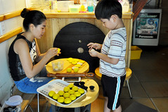 Just like mum (Roving I) Tags: wood cooking cakes boys children cuisine timber mothers vietnam buns tradition helping danang rollingpins hairbuns