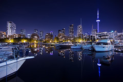 Skyline of Toronto (roken-roliko) Tags: city nightphotography travel blue sky toronto ontario canada reflection building tower water skyline architecture night outdoors photography boat cityscape cntower waterfront harbourfront bluehour modernbuilding yachtclub destinations buildingexterior architectureexterior cityandarchitecture rolandshainidze