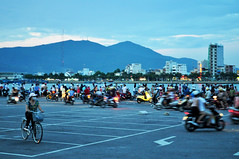 Sombre evening (Roving I) Tags: sunset tourism events crowd vietnam bicycles vigil danang hanriver tragedies wharves tourboats motorscooters