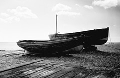 Beached - Deal, Kent (35mm) (jcbkk1956) Tags: blackandwhite film beach analog 35mm boats mono wooden kent wideangle deal converted manual planks slipway walmer sleepers agfa200 contrejoure worldtrekker