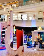 having fun on the moon (SM Tham) Tags: decorations moon girl asia child interior crescent indoors malaysia shoppingmall shops kualalumpur atrium domes ramadan aidilfitri minarets oillamps giantcard nusentral