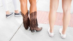 Fashion Statement (Wes Iversen) Tags: chicago feet leather illinois shoes legs boots sidewalks fringes cowboyboots tennisshoes odc cowgirlboots nikkor18300mm ourdailychallenge