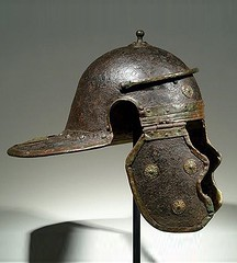 Ancient Rome.  Legionary iron and bronze helmet of the Mainz- Weisenau type (side view), 1st century AD. Many of the appliques had a purpose other than decorative: they helped reinforce the helmet and deflect blows. (mike catalonian) Tags: bronze iron helmet sideview legionary ancientrome 1stcenturyad mainzweisenautype