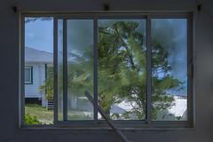 Broken Window (-j-o-s-e-) Tags: blue trees sea sky seascape storm building abandoned beach window water open empty hurricane ivan ruin shore damage caribbean cayman wreck damaged reef wrecked