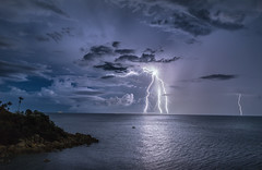 Tropic Thunder II (Jerry Fryer) Tags: sea sky seascape storm clouds palms landscape thailand coast kohsamui tropical bluehour lightning 6d graniterocks ef1635mmf4l