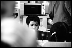 Serious expression. (ykpopy2011) Tags: people blackandwhite bw white black film monochrome japan kyoto child pentax bokeh f28  fa 2870   pentaxfa2870f28al