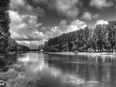 Emajogi River, Tartu, Estonia in Black and White (sawelli) Tags: blackandwhite water clouds river estonia rivers dramaticsky cloudysky tartu riverlandscape northerneurope peacefulriver calmriver emajogiriver