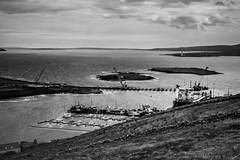 Stromness B&W (MBDGE) Tags: sea lighthouse water clouds port marina landscape boats scotland pier boat orkney marine rocks waves ship harbour crane ships hill shoreline wave hills shore hoy stromness scapa renewables