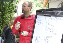 Rob Avis teaching a course about rocket stoves. (Green Energy Futures) Tags: wood calgary fire burning flame stove alberta permaculture efficiency woodburning biomass rocketstove rocketmassheater greenenergyfutures