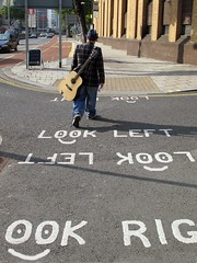 not looking right (and not looking left either) (pix-4-2-day) Tags: street man face look tarmac sign bristol guitar right smiley acoustic busker left pix42day
