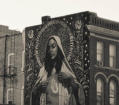 Salt Lake Guadalupe (andrewhyder) Tags: flowers windows urban blackandwhite woman streetart flower brick art history window face buildings utah eyes hand jesus naturallight saltlakecity fireescape guadalupe virginguadalupe