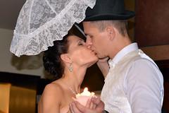 kiss under sunshade (Dmitry Kaminsky) Tags: wedding love umbrella happy bride kiss joy young marriage husband latvia sunshade wife justmarried riga fiance fiancee bunchofflowers saulkrasti baltakapa