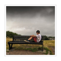 Forlorn (Photo Gal 2009) Tags: sadness oscar alone sad mud thoughtful dirty lone pensive muck unkempt muddy greysky badweather forlorn unloved mucky lonley dirtyboy childportrait uncared sadboy muddyboy naturallightportrait boyportrait sadportrait muckyboy muckychild boysitting dirtychild muddychild