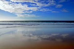 El sueo de la inmenso (Claudia Gaiotto) Tags: ocean clouds reflections sand playa dreaming reflexos isla atlantico marea sueno sogno cotillo canariacanary islandsbassa