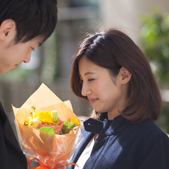 Young couple looking at a flower bouquet (Apricot Cafe) Tags: male smiling japan female asian japanese togetherness cafe couple internet young lifestyle happiness wireless casual f18 relaxation portlait istockalypse tokyo modelshooting canonef85mmf18usm modelreleaseready artschiyoda33313331 img544082
