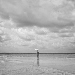 """A Lady will walk but never run"" (helmet13) Tags: leicaxvario raw bw woman sandbar ocean umbrella seychelles sky clouds silence vacation summer she aoi heartaward peaceaward 100faves world100f gettyimages feminine simplicity"
