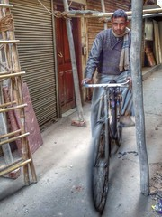 lajpat nagar | new delhi. (alyssaBLACK.) Tags: travel people india man male bike movement alley asia cyclist candid delhi bikes cycle hdr newdelhi peoplewatching