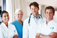 Group of friendly doctors standing together at a hospital (asesoriawebmx) Tags: portrait people woman white man male girl beautiful smiling modern female standing work hospital denmark happy person team uniform looking diverse adult natural background joy group young fresh professional medical business staff health human together doctor attractive medicine nurse care cheerful clinic ethnic job success healthcare colleague stethoscope physician multiracial occupation