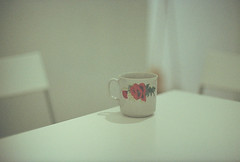 Poppy mug (Andrey Timofeev) Tags: flowers light white color film analog 35mm canon table photography 50mm focus gallery mood colours shadows chairs time little tea kodak russia ae1 bokeh small 14 grain atmosphere shades poppy poppies mug analogue manual expired tones 800 canonae1program expiredfilm       ultramax smalldof    colornegativefilm smalldepthoffield    35 kodakultramax800        vcsi   canonlensfd50mm14  julyaugust2014 developbefore072013