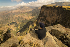 High Above It All (departing(YYZ)) Tags: africa travel people cliff mountains green yellow rock trek wonder landscape dangerous view sony vertigo canyon hike rockface adventure hanging daytime fe ethiopia alpha viewpoint ultrawide hang tranquil a7 selfie ultrawideangle simienmountains 14mm samyang backtothecamera