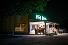 Wise Bros (Notley) Tags: longexposure windows light tractor shop architecture night facade rural spring farm may missouri callawaycounty nocturne farmequipment 2016 10thavenue notley notleyhawkins callawaycountymissouri missouriphotography httpwwwnotleyhawkinscom notleyhawkinsphotography wisebros wisebrothers