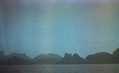(trom.pom) Tags: celestial 35mm analog filmphotography expiredfilm zenit12cd angthong nature thailand svemaco65 rainbow grain dust surreal cosmic atmosphere ocean mountains islands travel leak blue lofi