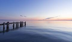 Blue Waves (martinaschneider) Tags: longexposure sky lake ontario beach water clouds sunrise pier lakeontario fiftypoint