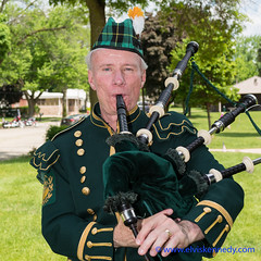 100 Days of Summer #1 - The Bagpiper (elviskennedy) Tags: park camera summer portrait music sun holiday man green reed face closeup wisconsin digital america outside us war unitedstates roman outdoor sony sunny blow parade musical american heat instrument conflict bagpipes veteran wi kennedy worldwar bagpiper memorialday grafton rx1 wwwelviskennedycom elviskennedy rx1r rx1rii rx1rmkii dscrx1rii