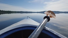 Cliche Kayak View (mazzmn) Tags: blue summer lake reflection water minnesota clouds outdoors boat kayak pov paddle peaceful calm shore bow lakeshore hcs