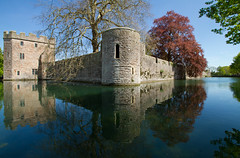 Spring at the Bishop's Palace (Mukumbura) Tags: blue trees england sky reflection building castle history water architecture spring peace cathedral peaceful wells somerset calm drawbridge walls moat protection fortress turret springtime copperbeech gatehouse tranquilscene bishopspalace peacefulscene