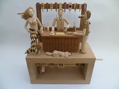 The Mermaid of Blake Mere automaton (Wanda Sowry) Tags: show wood red colour beer yellow bar toy moving wooden movement oak pub pumps parts cam tail exhibition purse yew mermaid pint redhair legend cog ginandtonic mechanism myth storytelling automata automaton optics shirehall themermaid stafforshire blakemere bilstoncraftgallery blackmere cluchbag