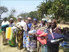 receiving quilts in Katete, Zambia (CLWR1) Tags: kits quilts zambia shipment wecare wecarekits
