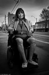 Mean Street Blues. (Neil. Moralee) Tags: street old bw woman white toronto canada black monochrome subway sad ttc wheelchair mature disabled struggle disabilities disability accessibility d7000 neilmoraleenikon meanstreetblues disabiliyt