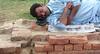 Sirf neend (Raja Islam) Tags: pakistan sleeping man brick relax shoe newspaper sleep bricks poor pillow sheet karachi chappal