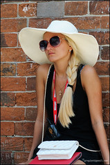 Whisper .... (ColinB Portraits) Tags: street venice portrait woman public hat sunglasses female hair bag skinny glasses necklace waiting pretty sitting candid longhair relaxing streetphotography streetportrait streetscene brickwall blonde attractive mobilephone reality ponytail earrings thin handbag stmarkssquare headwear lanyard shoulderbag candidportrait candidphotography streetcandids colinb casualstreetcandid