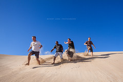 Four people running down a sandhill, Australia (Robert Lang Photography) Tags: blue people men fall boys fun happy four hilarious jump sand funny adult 4 hill australia bluesky down guys running run sa adults southaustralia sandhill goodtimes blokes robertlang 4people eyrepeninsula childatheart coffinbaynationalpark gunyahbeach robertlangportlincoln robertlangphotography wwwrobertlangcomau fourpeoplerunningdownasandhill