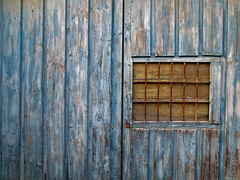 so far removed (maximorgana) Tags: door wood blue brown window bar decayed drelict fuentealamo