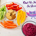 pink hummus mixed with beets fresh vegetable stick carrots peppers and crackers with personalized towel